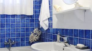 blue bathroom tile ideas: blue interior in bathroom and white sink closeup download