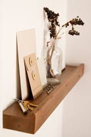 color and texture to a small apartment entryway with a light shelf for keys fresh flowers and letters something warm and inviting to come home astonishing home stores west elm