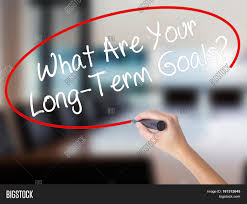 w hand writing what are your long term goals a marker w hand writing what are your long term goals a marker over transparent
