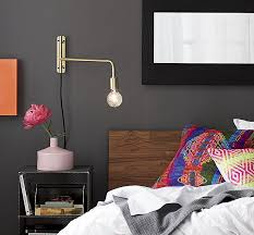 view in gallery brass wall sconce from cb2 cb2 swing arm brass wall
