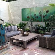 designs outdoor wall art: outdoor wall art attached on exposed brick wall painted in white for comfy outdoor sitting among