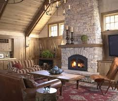 cozy rustic living room design with wooden sloping ceiling and stunning stone fireplace and unique candle pendant light with sofa on parsian area awesome pendant lighting sloped ceiling