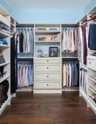 minimalist alexandra von furstenberg walk in closet with white drawers and clean shelves alexandra furniture