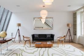 fitzroy development 1950s living room idea in london with white walls and medium tone hardwood floors antique lamp enchanting mid century modern