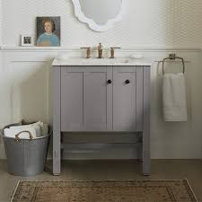 bathroom features gray shaker vanity: long legged shaker vanity with single hinged door and pullout sotrage in medium grey paint with