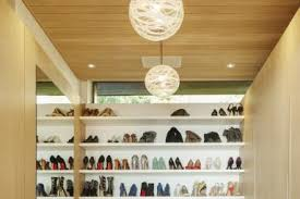 walk in closet with shoes on shelves astronaut imagescaiaimagegetty images best lighting for closets