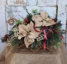 cabin decor lodge sled: rustic sleigh christmas arrangement with burlap poinsettias greenery pine cones great for cabin lodge rustic home decor snow sled by gypsyfarmgirl on