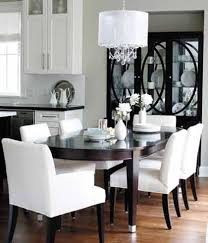 dining table parson chairs interior: laurel ridge homes white string crystal chandelier espresso oval dining table white parsons dining chairs black mirrored cabinet and gray walls