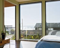 7 small beach houses we love dwell floor to ceiling windows in the bedroom create sensation caribbean bedroom furniture