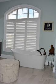 bathroom features gray shaker vanity: master bathroom with grey shaker vanity porcelain tile pebble shower floor oil rubbed