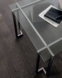 lord table with transparent glass top structure in bright stainless steel calabria stainless steel