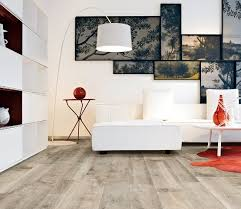 grey wood laminate flooring with white living room furniture beauty room furniture