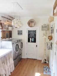 here is one of the laundry room off my kitchen i love this room to do laundry in it is bright and sunny with a big window chic laundry room