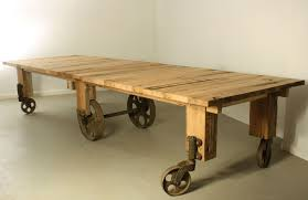 dining table with wheels: custom cart dining table by warnock woodwork