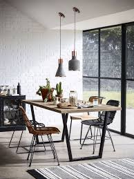 dining room table plans shiny: stark walls matte greys and shiny coppers look more relaxed and welcoming when teamed with a reclaimed timber table and gently curved mismatched rattan and