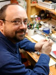 Millis puts his mind and heart into a lifelong hobby building slot cars at his workbench. Credit: Carly Millis - 256075main_July08_Clock_wkbench2