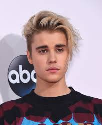 justin bieber singer biography com justin bieber photo courtesy d shutterstock