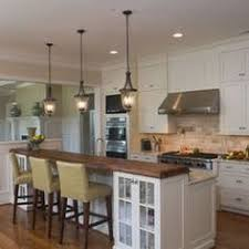 island with breakfast bar seating like the hanging lights breakfast bar lighting