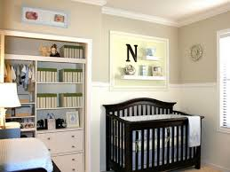 natty built in bookshelf mixed with grey wall and white wainscoting in modern small baby nursery baby boy furniture nursery