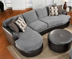 chic gray velvet and black leather sectional sofa with chaise right side and durable bonded leather round ottoman coffee table ideas to make cozy living chic cozy living room furniture