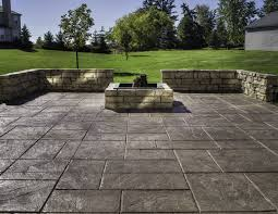 stone patio installation: awesome landcape around from stamped concrete patio plus amusing ssstone edge and blue sky