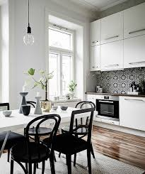 black kitchen dining sets: big kitchen dining table and thonet chairs