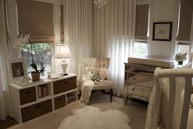 adorable chic white gender neutral nursery design with borghese mirrored chest changing table ivory tufted west elm linen cotton grommet window panels borghese mirrored furniture