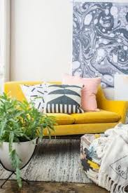 bright yellow couch pops against the greys in this room bright yellow sofa living
