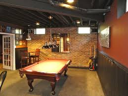 rustic basement man cave billiards room with brick wall and exposed wood beams basement rec room decorating