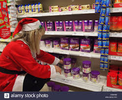 store assistant dressed as father christmas 14 2014 store assistant dressed as father christmas stocking the shelves just before christmas