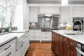 kitchen backsplash stainless steel tiles: white kitchen cabinets with stainless steel subway tile backsplash
