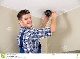 technician installing surveillance camera stock photo image technician installing surveillance camera