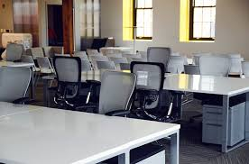 chairs and tables in a office buying an office chair
