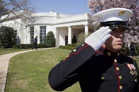 a marine salutes as president obama returns to the oval office barack obama enters oval