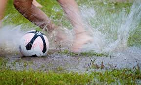 Image result for pictures of footballers in the rain