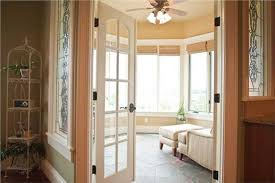 home office doors with glass. a multipanel glass door opens to the sitting area of this master suite in twostory luxury country home plan 1611030 touch green paint and office doors with