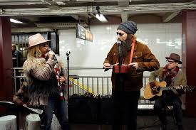 Alanis Morissette busks with Jimmy Fallon in a New York subway ...