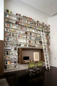 high bookshelf wall with ladder set around floating computer desk plus double green swivel chairs designed in modern style amusing double office desk
