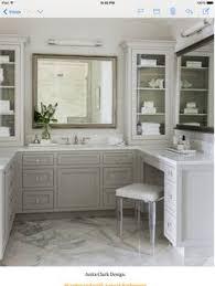 bathroom features gray shaker vanity: absolutelystunningbathroomfeaturesagraybuilt invanitytoppedwithwhitemarblepairedwithalucitevanitystoolunderanantiquednickelvanity   absolutelystunningbathroomfeaturesagraybuilt invanitytoppedwithwhitemarblepairedwithalucitevanitystoolunderanantiquednickelvanity
