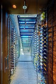 stunning wine cellar under the staircase with limestone floor design kevin b howard architects box version modern wine cellar
