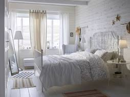 a white small bedroom furnished with a romantic metal bed for two combined with side tables bedroom furniture in ikea