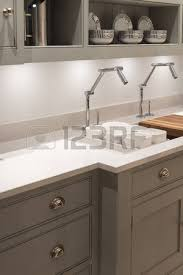 avant garde modern and contemporary kitchen with avant garde faucet taps stock photo avant garde faucet