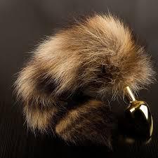 <b>Маленькая золотистая анальная пробка</b> с полосатым хвостом ...