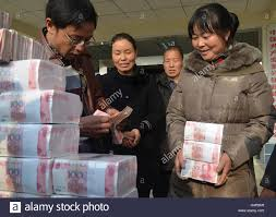 ling xuxia collects her yuan year end bonus at ling xuxia collects her 314 000 yuan 51 935 year end bonus at jianshe village liangshan sichuan province 14 2014
