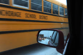 dermot cole alaska dispatch news an anchorage school district school bus travels down spenard road in traffic in anchorage alaska