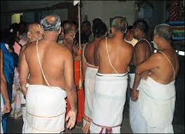 Image result for images of brahmins wearing Janeu over the ear