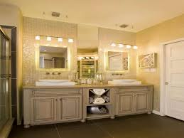 bathroom light fixtures over mirror with traditional cabinets colors bathroom lighting tips