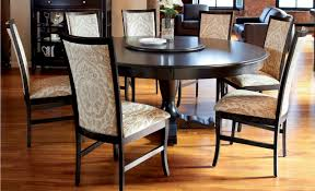 kitchen pedestal dining table set: kitchen  black shiny round dining table flower with vase on the table black cupboard side wooden flooring ideas brown leather club chairs