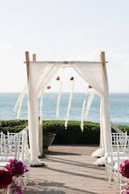 day orchid decor: wedding canopy with white drape white orchid strings amp glass globes filled with red flowers
