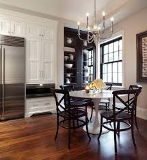 kitchen cabinets home office transitional: black built kitchen transitional with white cabinets formal parsons dining chairs